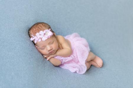 Baby girl sleeping on her tummy
