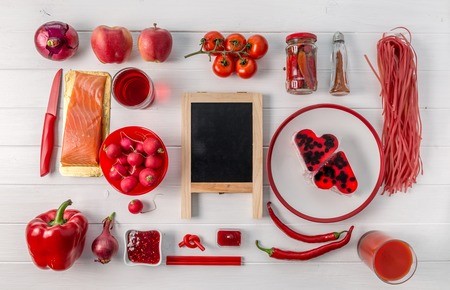 Collection of red food, chalkboard in center, topview Stock Photo