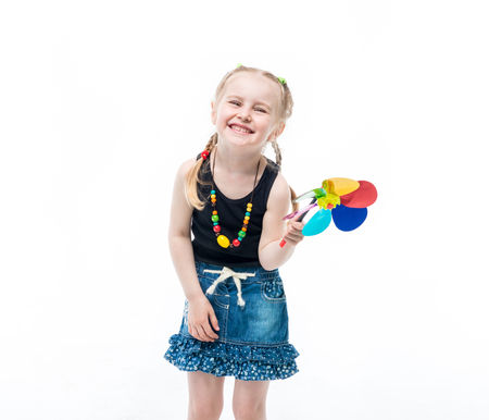 child with a spinner toy, wearing a top Stock Photo