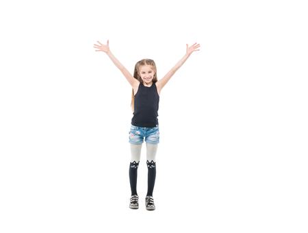 teen girl raising hands and smiling widely