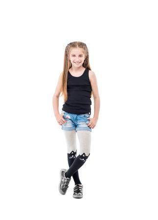 Lovely teenage girl, hands on hips, posing