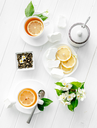 Green jasmine tea ceremony with marshmallow, topview Stock Photo