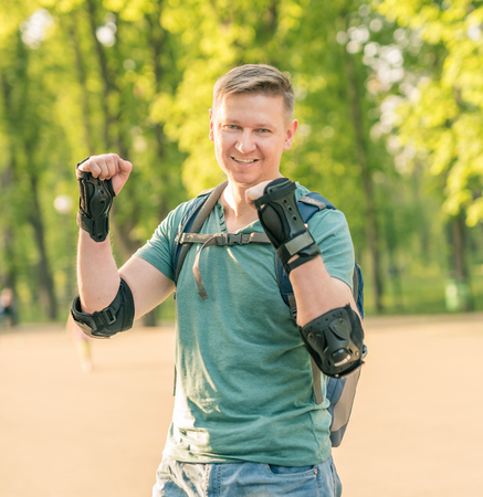man wearing protection for active sport smiling photo