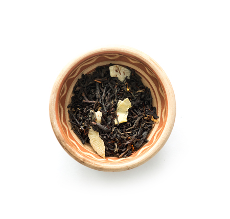 Black tea with pieces of dried fruits, topview Stock Photo