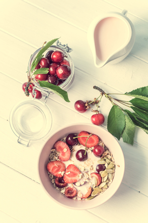 Healthy breakfast with muesli and cherries, topview
