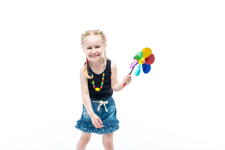 smiling blonde kid with spinning toy wearing tanktop