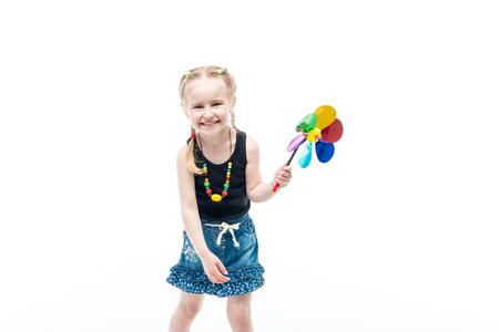 smiling blonde kid with spinning toy wearing tanktop