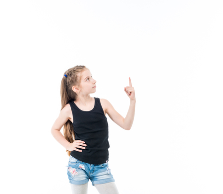 Teen girl with straight hair pointing upward