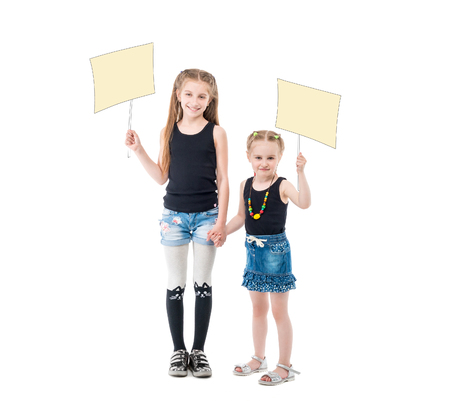 sibling sisters holding hands, blank posters Stock Photo - 81170038