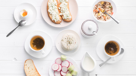 filling breakfast with salad, cheese and oatmeal, topview