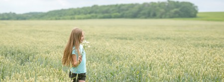 plucking: Panoramic shot of a girl in a field