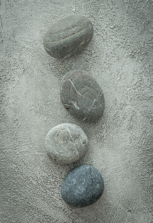 pebble stones for hot massage in spa, topview Stock Photo