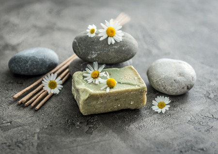 Handmade soap with chamomile, smoking lavender sticks