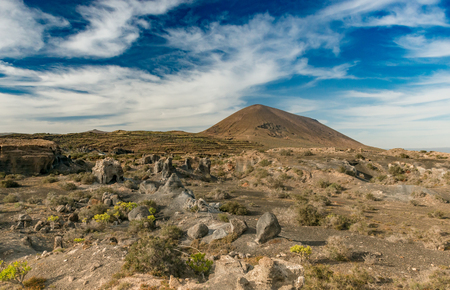 picturesque landscape of Lanzarotte desert and blue sky Фото со стока