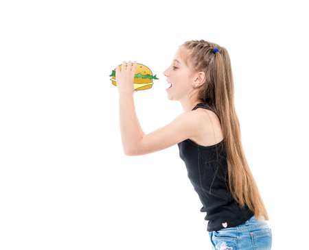 teen girl eating hamburger Stock Photo