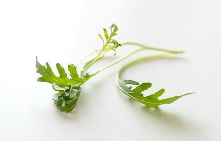 Leaf arugula on white background Stock Photo