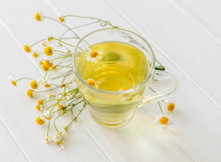chamomile tea in a transparent cup Stock Photo