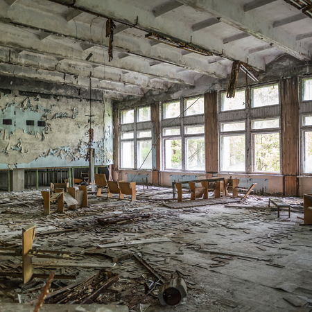 ruined assembly hall with debris in abandoned Pripyat school