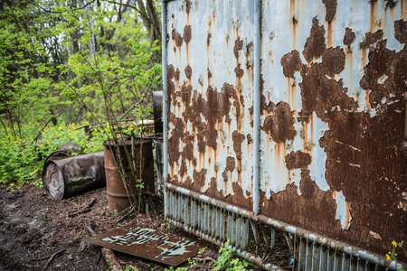 rusty booth and barrels in abandoned Pripyat