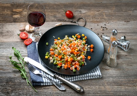 Yummy pilaf with vine and tomatoes on side Stock Photo