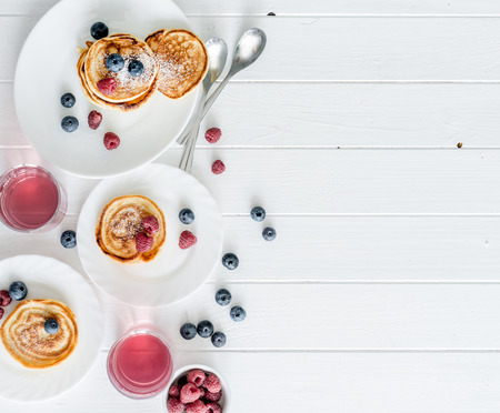 homemade fritters with raspberries and blueberries