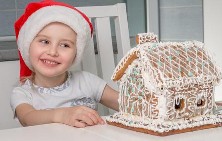 beautiful little girl with sweet cake-house Stock Photo