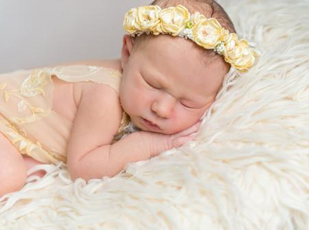 Little baby girl sleeping on her side Banco de Imagens