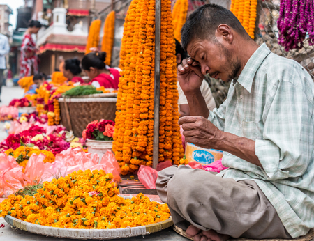 People sell flower necklaces near to Kathmandu Durbar Square