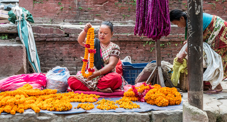 People sell flower necklaces next to Kathmandu Durbar Square