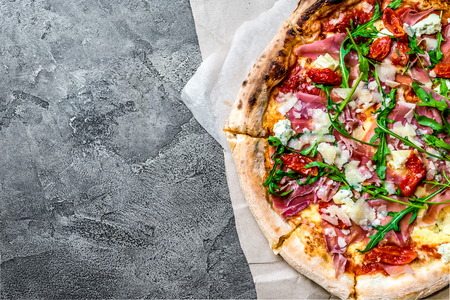 Pizza with a jamon and rucola