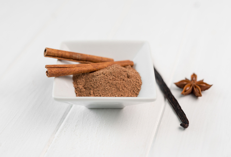 cinnamon and vanilla on a white background