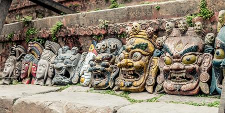 Nepalese traditional demon mask under the wall, Kathmandu, Nepal Stock Photo