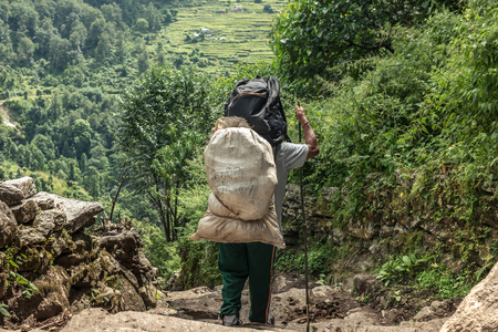 Man with sack on Annapurna trekking route.