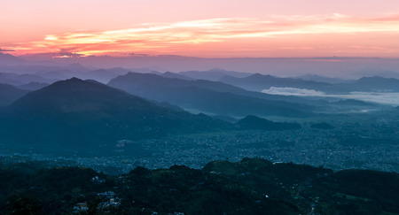 Twilight sky and mist over mountains, Pokhara city, Nepal Stock Photo - 91173117