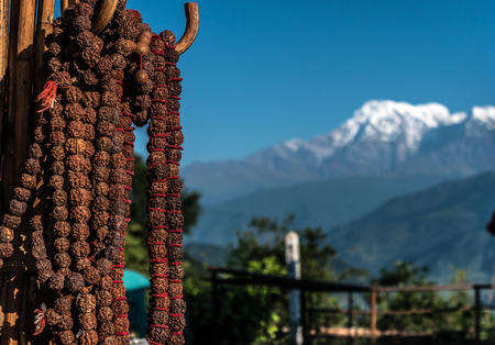 Nepalese prayer rosaries with red thread, Pokhara, Nepal