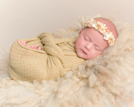Newborn girl sleeping, wrapped up with a blanket Stock Photo