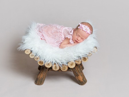 Cute newborn girl sleeps peacfully