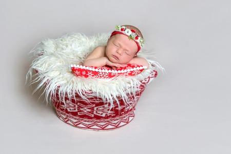 Newborn baby in santa claus bonnet