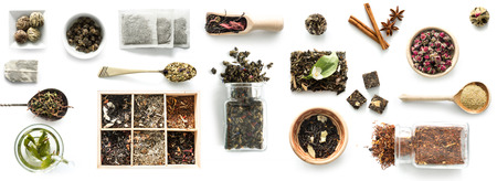 Various kinds of tea, spoons and rustic dishware, brewed green tea, cinnamon