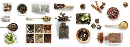 Various kinds of tea, spoons and rustic dishware, brewed green tea, cinnamon