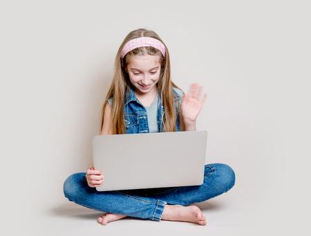 Little girl talking via video chat