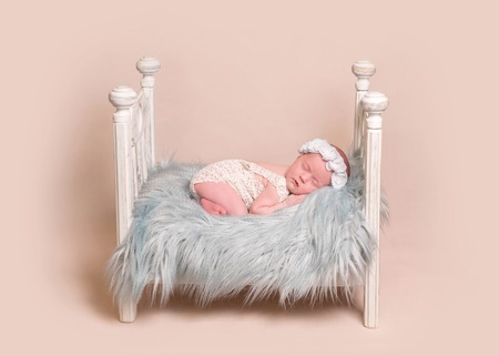 newborn baby girl sleep on the bed