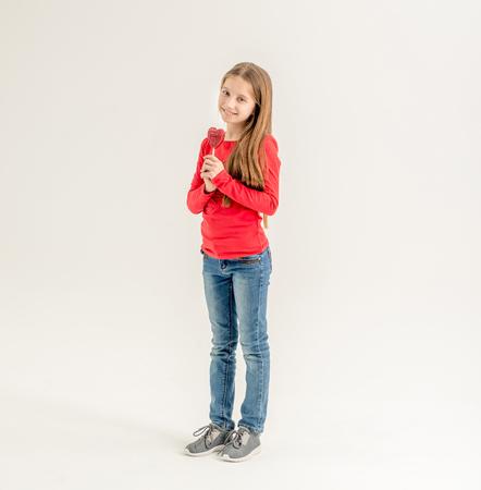 teenage girl with heart shaped lollipops