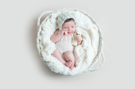 Newborn baby sleeping in wicker basket