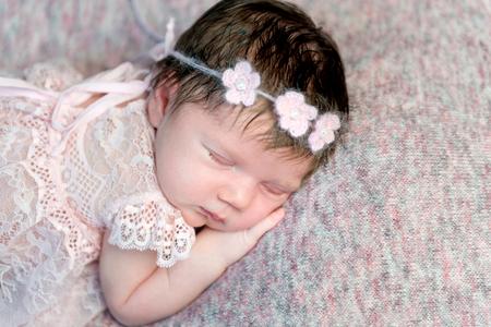 Lovely newborn girl in dress sleeping Banco de Imagens