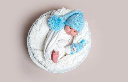 Lovely newborn lying on bowl