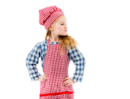 Girl in red plaid apron standing in akimbo pose
