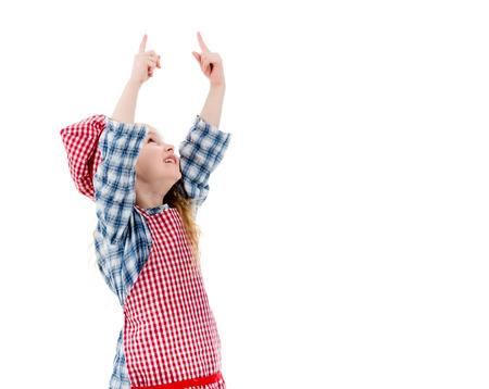 手を上げる小さなシェフの女の子 写真素材