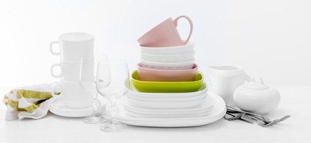 Pile of colourful square dishes and cups Stock Photo