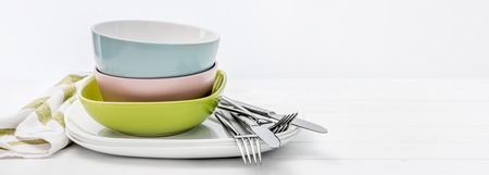 Ceramic bowls with silver cutlery